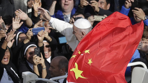 Pope Francis is seen covered by the Chinese communist red flag