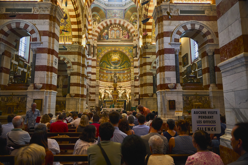 Mass in the church of Notre-Dame de la Garde. The golden roofs of this temple are very beautiful. It is adorned with fishermen`s boats