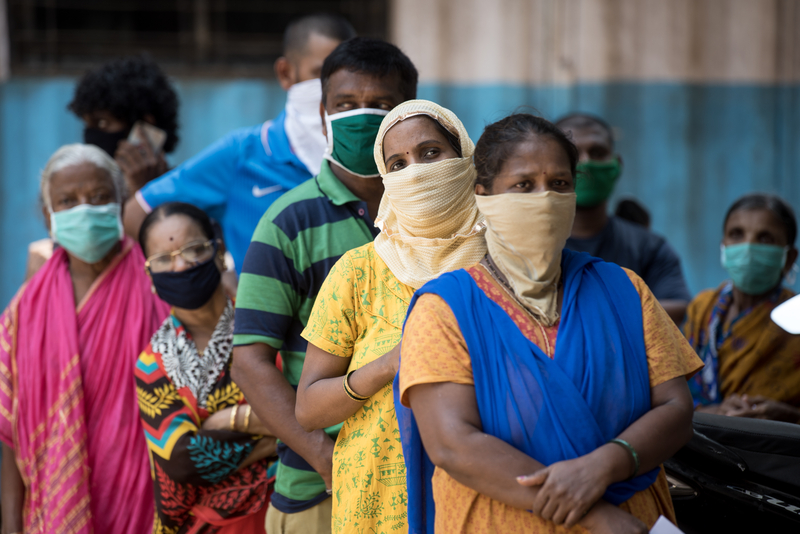 Residents stand in a queue to get tested for the the COVID-19 coronavirus during a nationwide lockdown in India.